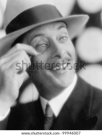 Cheerful man with monocle - stock photo