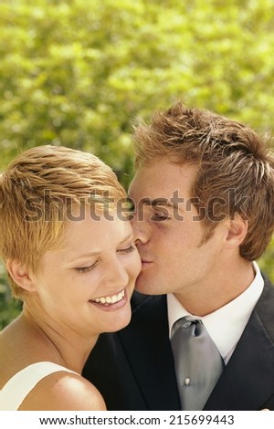 Cheerful married couple at their wedding full of love - stock photo