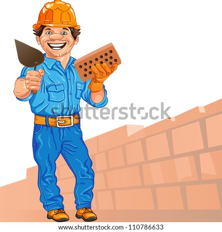 cheerful mason in the orange helmet with brick and trowel in hand, against a background of brick wall - stock photo
