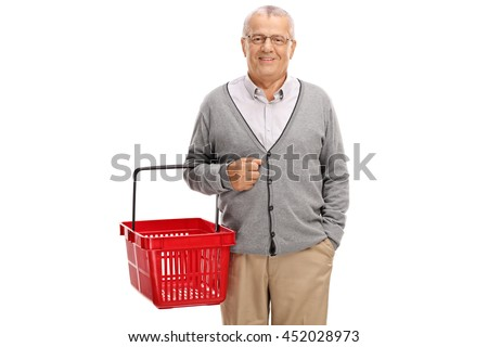 Cheerful mature man holding an empty shopping basket isolated on white background - stock photo
