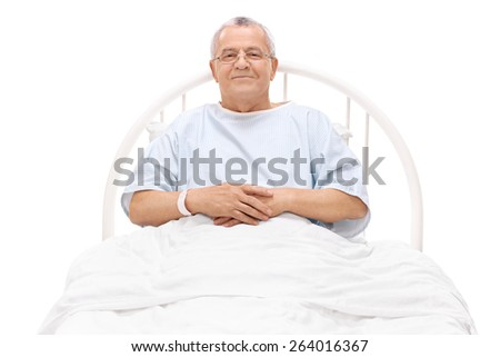 Cheerful mature patient lying in a hospital bed and looking at the camera isolated on white background - stock photo