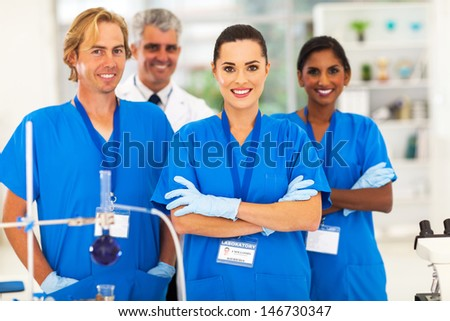 cheerful medical researchers in lab - stock photo