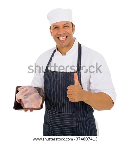 cheerful mid age butcher holding best quality meat - stock photo