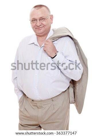 Cheerful middle aged man wearing glasses, shirt with open collar and beige suit standing with jacket over his shoulder and smiling isolated on white background - happy retirement concept - stock photo
