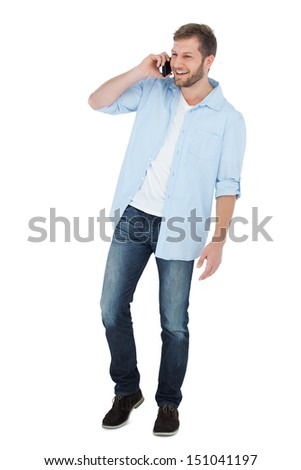 Cheerful model on the phone on white background - stock photo