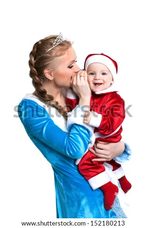 Cheerful mother and baby posing in fancy costumes - stock photo