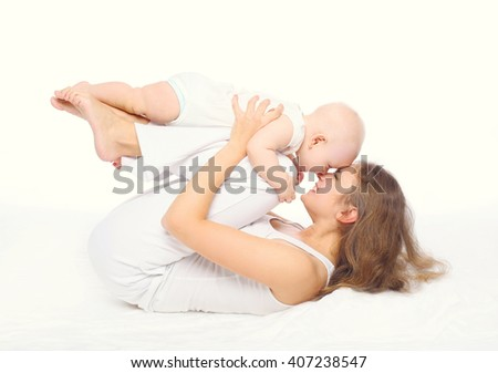 cheerful mother playing with baby on white background - stock photo