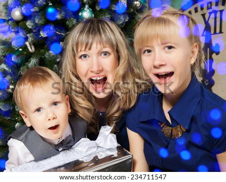 Cheerful mother with her son and daughter during celebration  new year  - stock photo