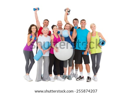 Cheerful people holding exercise equipment on white background - stock photo