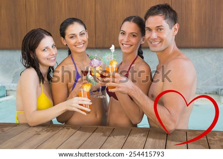 Cheerful people toasting drinks in the swimming pool against heart - stock photo