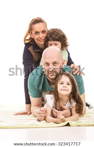Cheerful piled family home against white background - stock photo