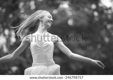 Cheerful pretty woman dancing - stock photo