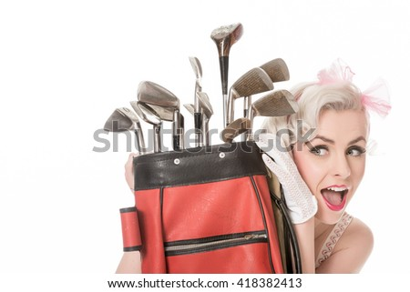 Cheerful retro girl peeking out from behind red golf bag, isolated on white with space for text, horizontal format - stock photo