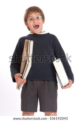 Cheerful schoolboy carrying heavy books - stock photo