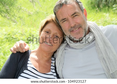 Cheerful senior couple relaxing on vacation - stock photo