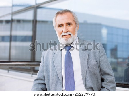 Cheerful senior man portrait outdoors - stock photo