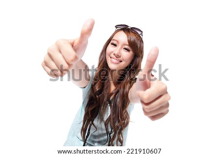 Cheerful smile woman tourist showing thumbs up success sign isolated on white background, asian - stock photo