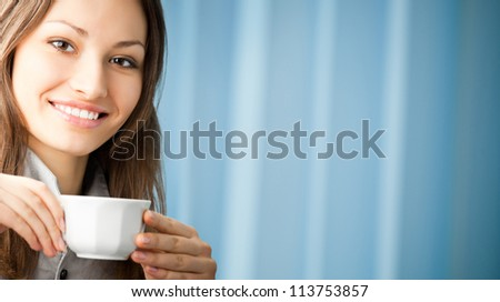 Cheerful smiling business woman drinking coffee at office. To provide maximum quality, I have made this image by combination of two photos. - stock photo