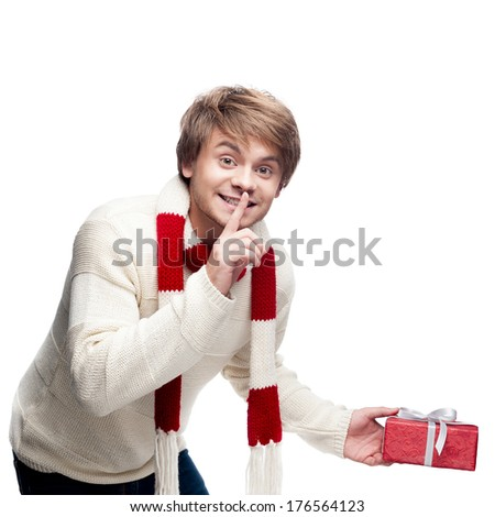 cheerful smiling caucasian man placing christmas gift isolated on white - stock photo