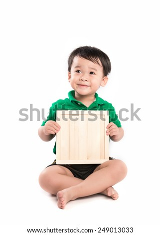 Cheerful smiling child holding the blackboard. School concept. isolated on white  - stock photo