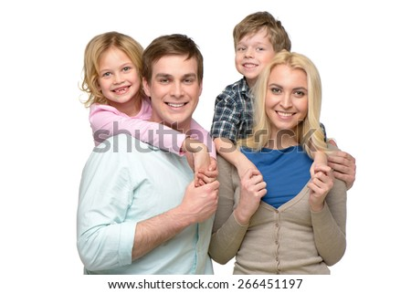 Cheerful smiling family of four enjoying time together and looking at camera. Isolated on white background. Concept for happy family - stock photo