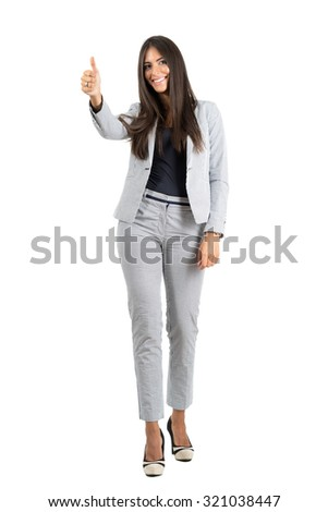 Cheerful smiling young business woman with thumbs up gesture.  Full body length portrait isolated over white studio background.  - stock photo