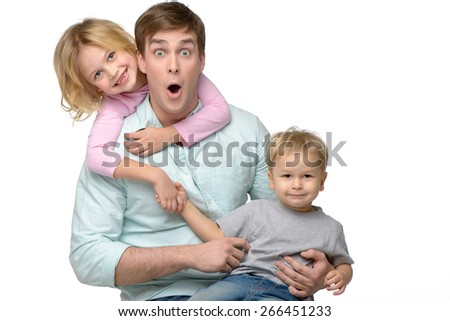 Cheerful smiling young father with his two kids. They having fun. Isolated on white background. Concept for happy family - stock photo