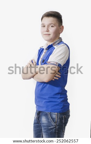 Cheerful teen in a blue shirt on a white background - stock photo