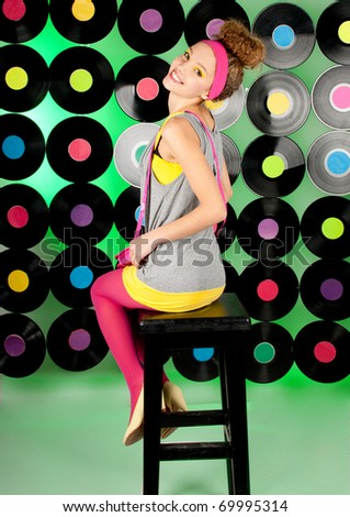 cheerful  teenage girl over colorful background - stock photo