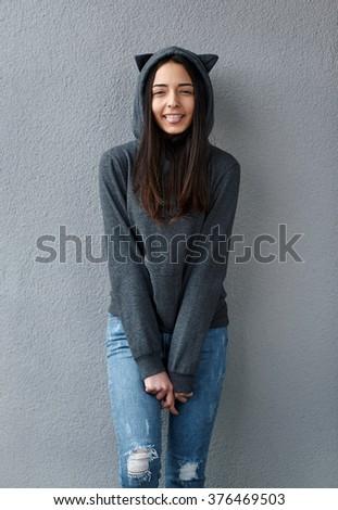 cheerful teenager girl showing tongue - stock photo