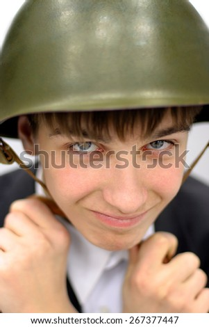 Cheerful Teenager in Military Helmet Portrait closeup - stock photo