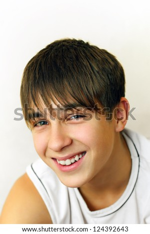 Cheerful Teenager portrait on the White background - stock photo
