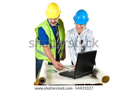 Cheerful two architects in office working on projects and laptop and the man showing her colleague woman something on plans   pointing with pencil isolated on white background - stock photo