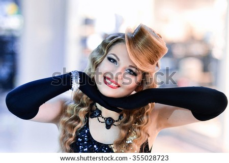 Cheerful,wavy hair,hairstyle,posing,young,blonde hair,super jewelry girl model with nice,cute smile,clean hear skin and hat from hair.Moulin Rouge.The best hair,cover of magazine.Madly,hair,long hair. - stock photo