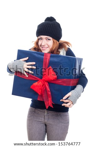 Cheerful winter woman holding big present, isolated on white background. - stock photo