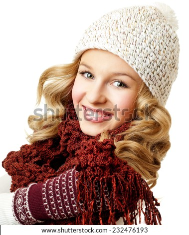 Cheerful woman clothing in warm hat. Winter season. - stock photo