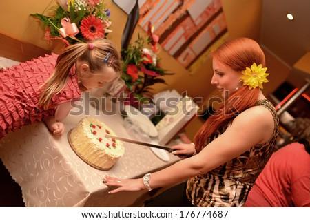 Cheerful woman eating pie - stock photo