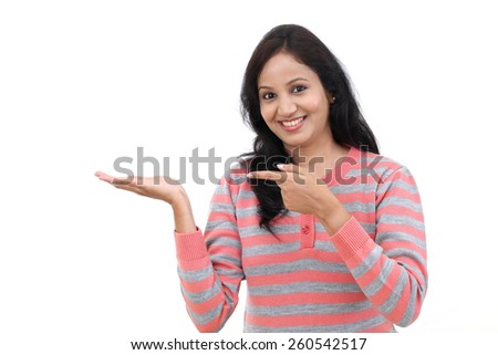Cheerful woman showing open hand palm with copy space - stock photo