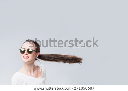Cheerful woman with hair in the wind. Beauty and Fashion - stock photo