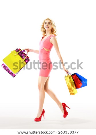 Cheerful woman with shopping bags - stock photo