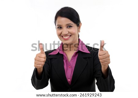Cheerful woman with thumbs up against white background - stock photo