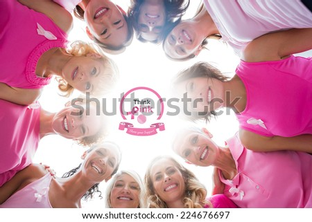 Cheerful women in circle wearing pink for breast cancer against breast cancer awareness message - stock photo