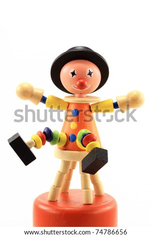 Cheerful wooden clown toy isolated on white background - stock photo