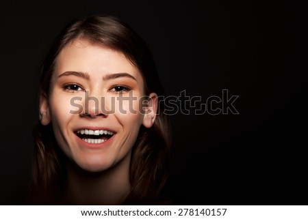 Cheerful Young Adult European Woman Smiling - Stock Image - stock photo