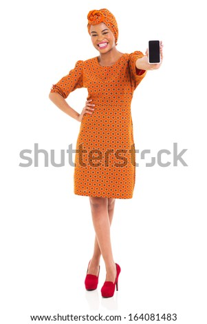 cheerful young african girl in traditional clothes showing smart phone - stock photo