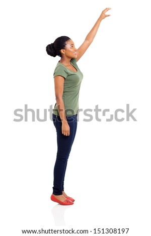 cheerful young african girl reaching something high isolated on white background - stock photo