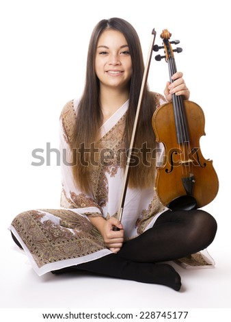 cheerful young asian woman holding violin or fiddle - stock photo