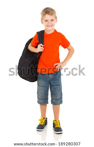 cheerful young boy carrying schoolbag - stock photo