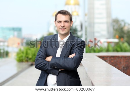Cheerful young businessman - stock photo