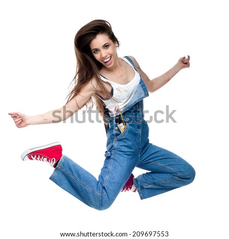 cheerful young caucasian crazy woman jumping and screaming isolated on white - stock photo